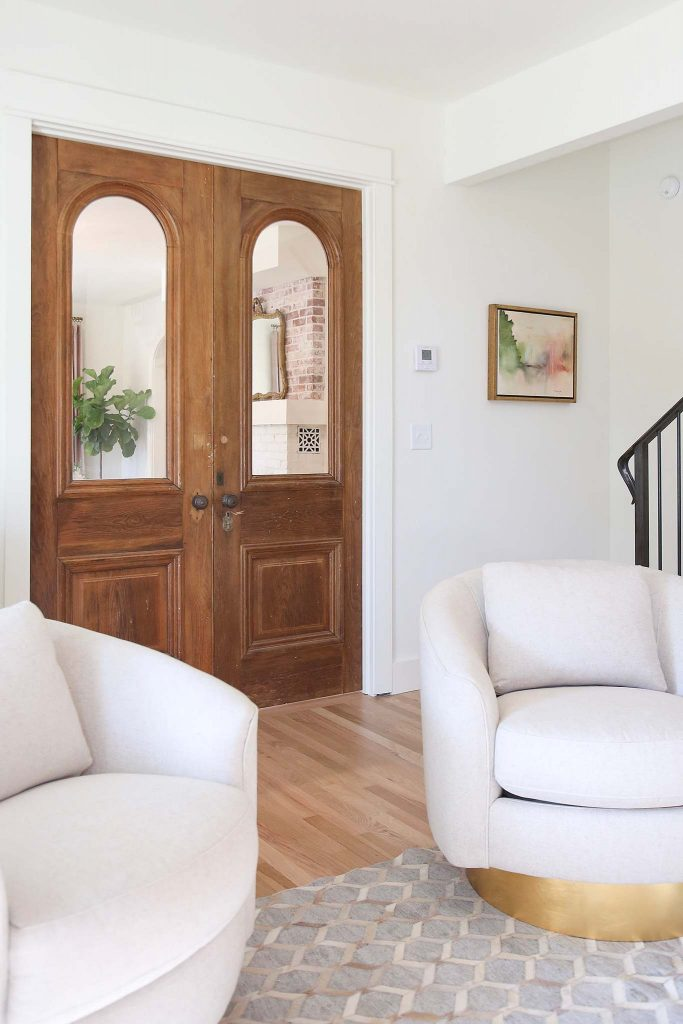 Refurbished antique doors make the perfect french door entry into this home office renovation.